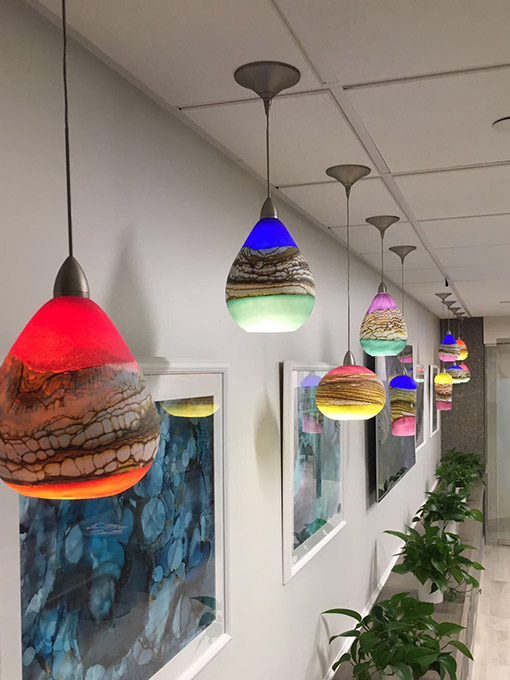 Glass pendant lights NYC installation
