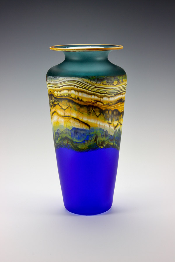 Translucent Strata series blown glass urn vase in sage green and cobalt colors