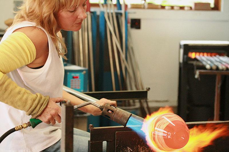 Danielle Blade blowing glass at Gartner Blade Studio