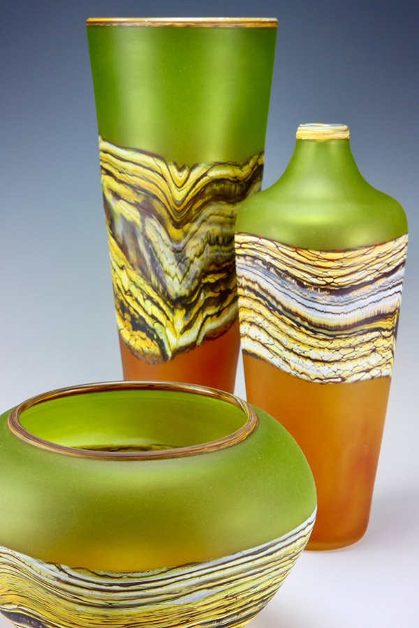 Translucent Strata series hand blown art glass vessel group in lime green and tangerine colors