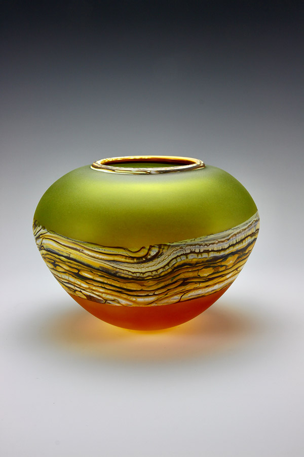 Handblown glass bowl translucent strata in lime and tangerine colors