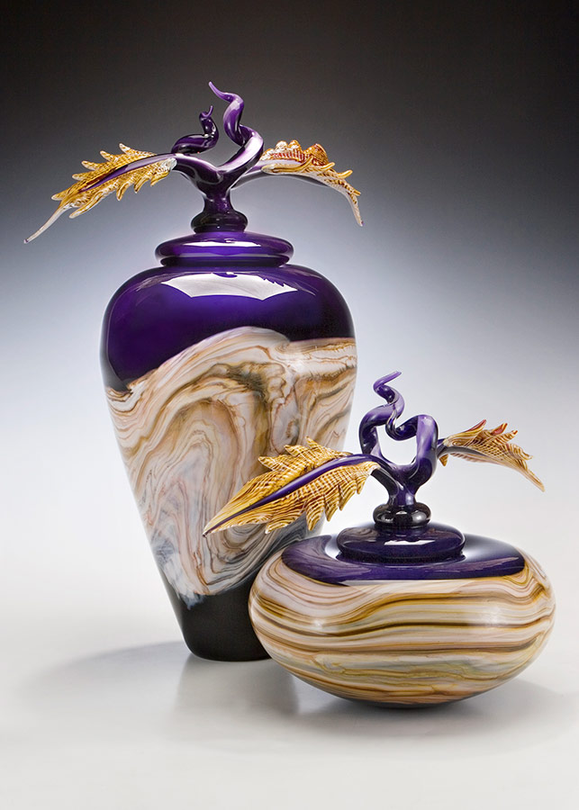 Amethyst glass vessel pair with lids and sculpted glass finials