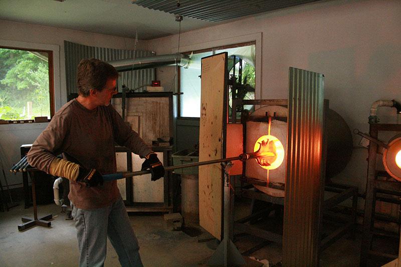 Stephen Gartner blowing glass sculpture