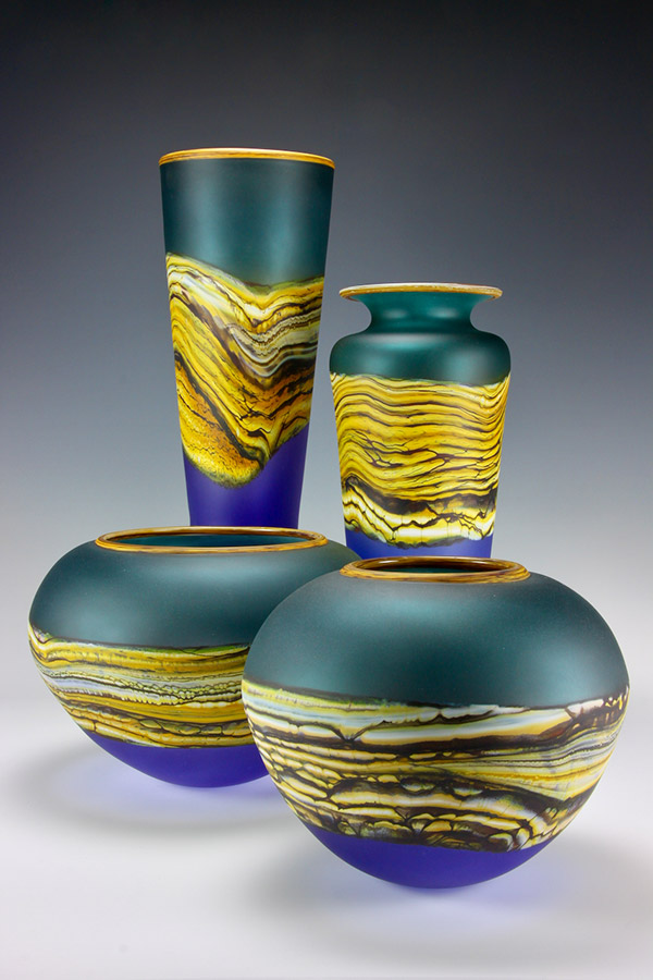 Translucent Strata series handblown glass vessels in sage and amethyst colors
