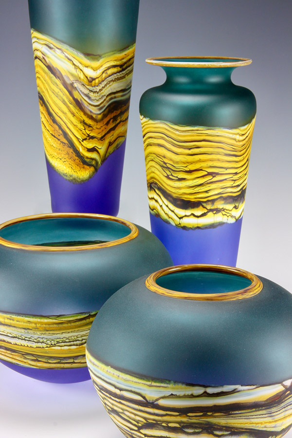 Translucent Strata series handblown art glass vessel group in sage and amethyst colors
