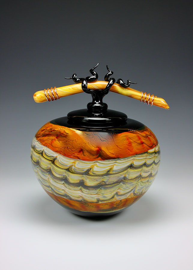 Hand blown glass vessel with lid and sculpted glass finial from the Black Opal series