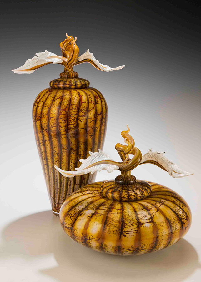 Hand blown glass vessel pair with sculpted glass finials lids from the Batik series
