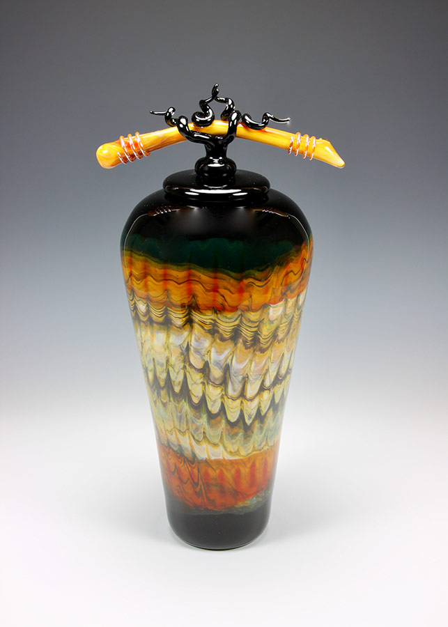 Hand blown glass vessel with lid and sculpted finial from the Black opal series