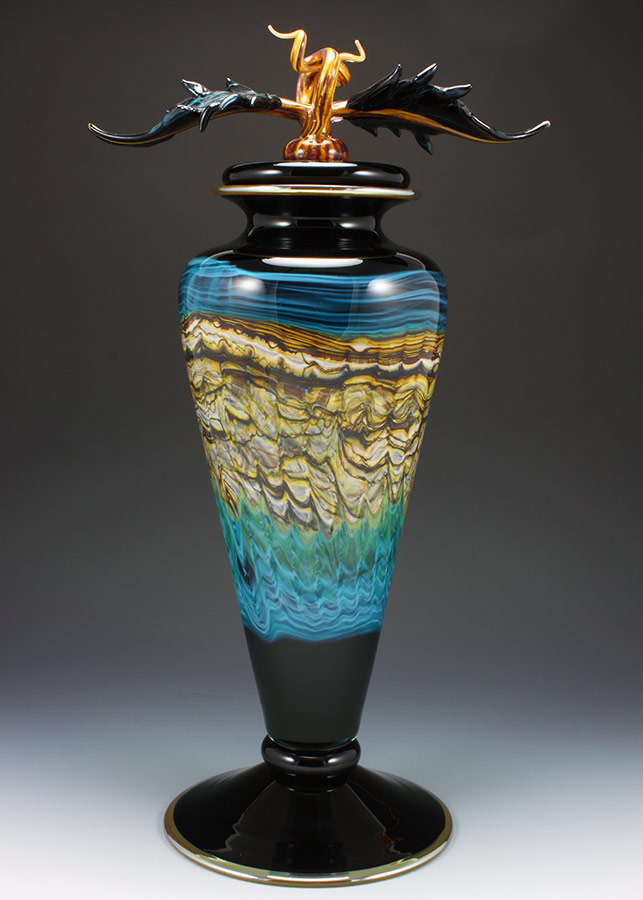 Handblown black opal with turquoise footed vessel with sculpted avian finial lid