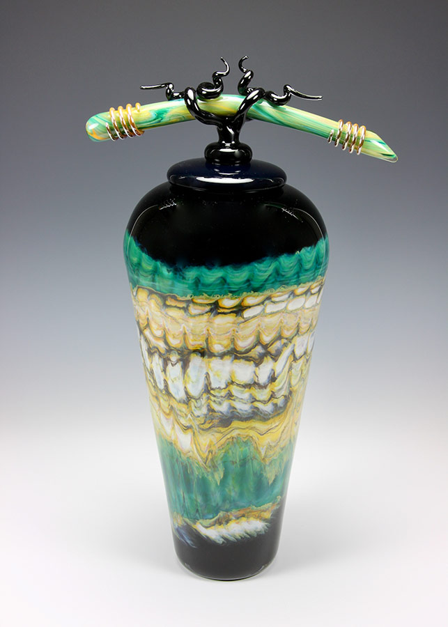 Hand blown glass vessel from the Black Opal series with lid and sculpted glass finial