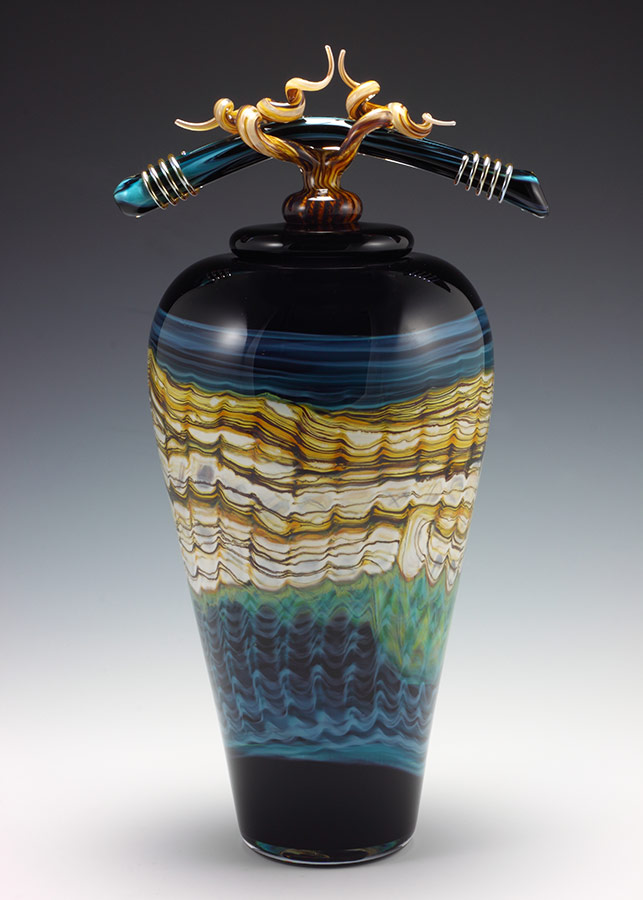 Handblown black opal with turquoise vessel with sculpted bone finial lid