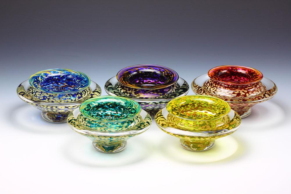 Handmade transparent glass ikebana bowls in jewel tones for floral arrangements